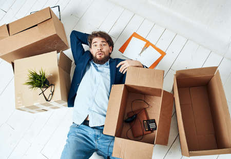 Business man with boxes office moving office official 스톡 콘텐츠