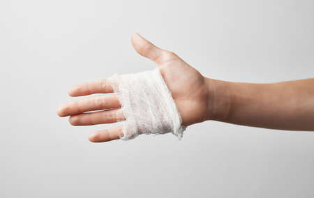 hand injury bandage health problems gray background