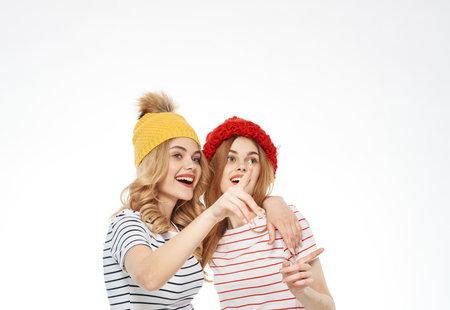 Cheerful girlfriends hugs communication joy friendship circumcised