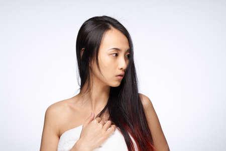 asian woman loose hair towel on body shoulders hygiene Stock fotó