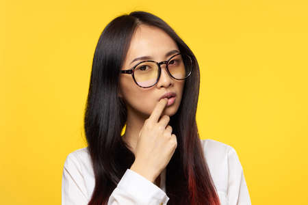 pretty woman wearing glasses elegant style lifestyle manager studio yellow background