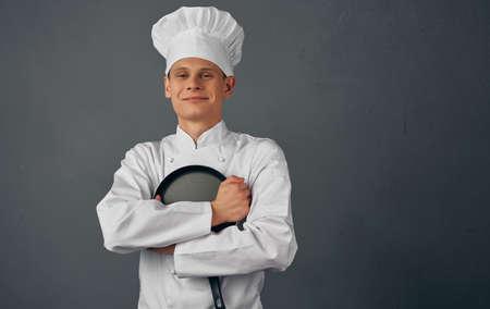 male chef kitchenware cooking in restaurant studio