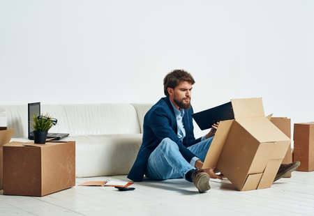 man unpacking boxes stuff office professional job official