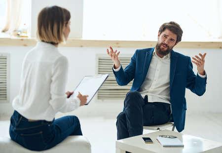 A man in a suit at a psychologists office near the window Reklamní fotografie