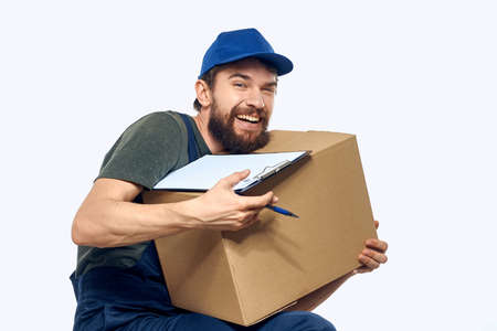 male working uniform box delivery by courier professional Archivio Fotografico