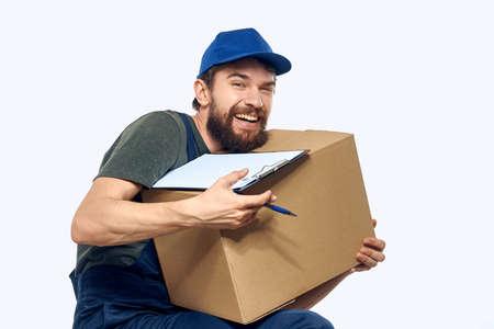 male working uniform box delivery by courier professional Foto de archivo