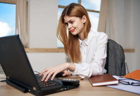 Woman secretary working desk laptop work office manager communication Foto de archivo