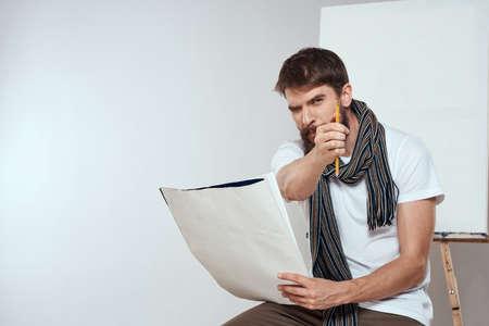 Man in white t-shirt artist drawing creativity work Stock fotó