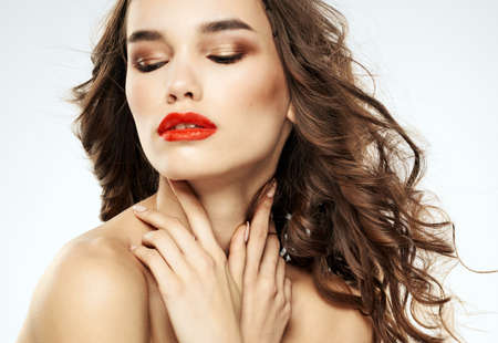 Charming lady with closed eyes eyeshadows and bright makeup red lips
