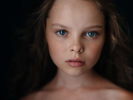 Girl confident look shoulders portrait close-up beautiful face Stockfoto