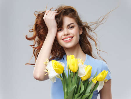 cheerful woman with bouquet of flowers female holiday joy isolated background