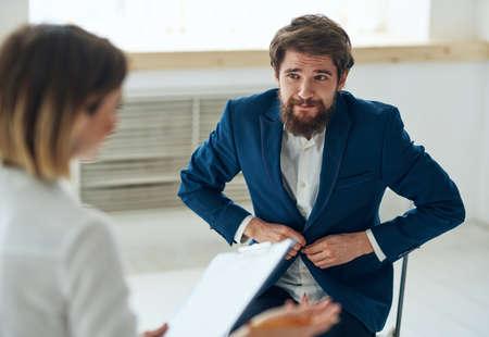 a man at a psychologists appointment communication problems health diagnostics