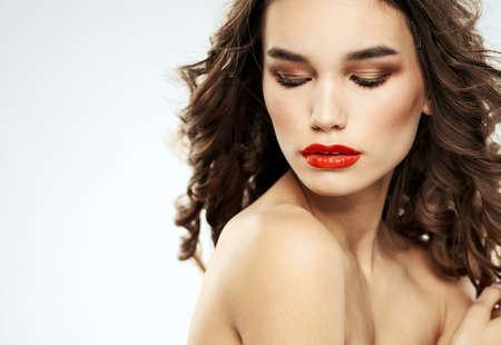 Woman brunette red lips shadows on eyelids portrait shoulders