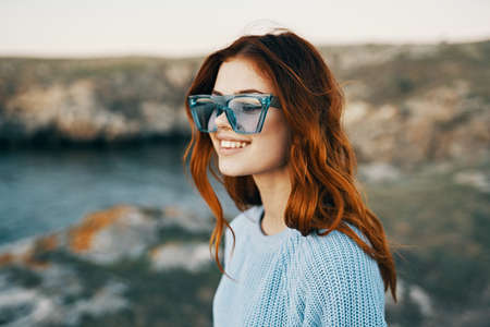cheerful pretty woman in blue glasses outdoors travel luxury