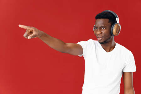 emotional man in headphones gesturing with hand circumcised with copy space