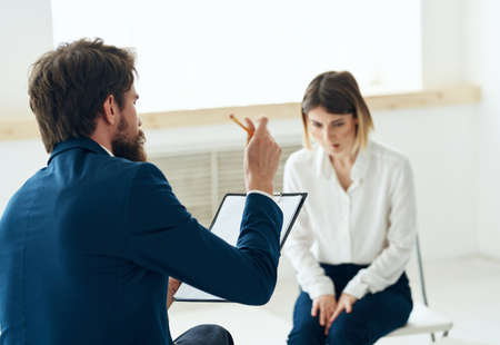 A man next to a woman communication discussion professional consultation mental problems
