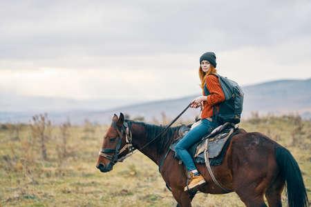woman hiker riding horse travel mountains landscape