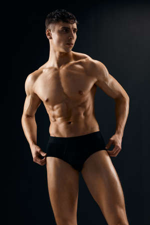 handsome man with muscular body dark panties macho model