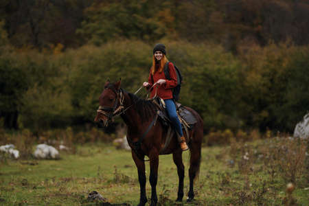 Woman riding horse outdoors fresh air travel landscape Stock Photo