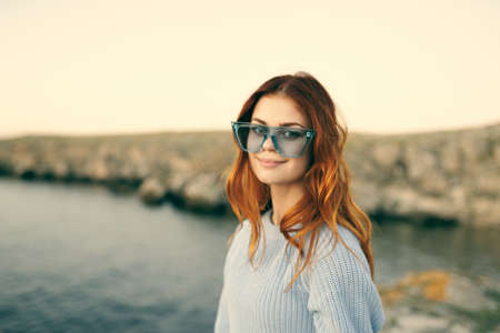 woman with glasses outdoors landscape island travel Archivio Fotografico