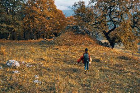 woman hiker nature walk autumn forest mountains