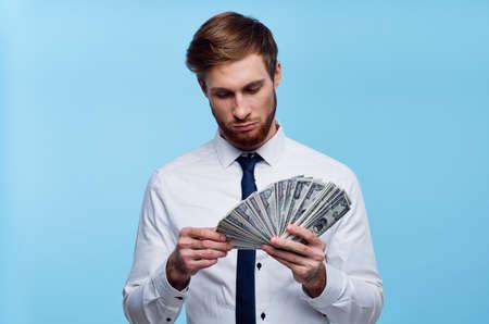 business man in shirt with tie bundle of money finance wealth Standard-Bild