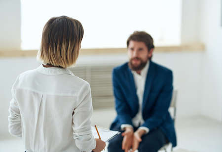 a man at a psychologists appointment therapy stress treatment communication