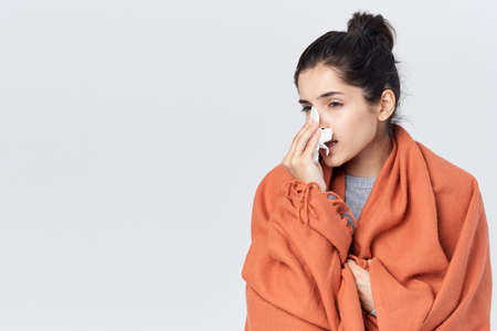 woman with a cold wipes her nose with a handkerchief flu Standard-Bild