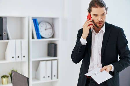 businessmen at the desk documents communication by phone Lifestyle