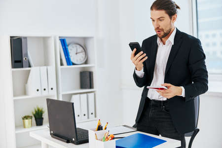 manager office work documents with a phone in hand boss