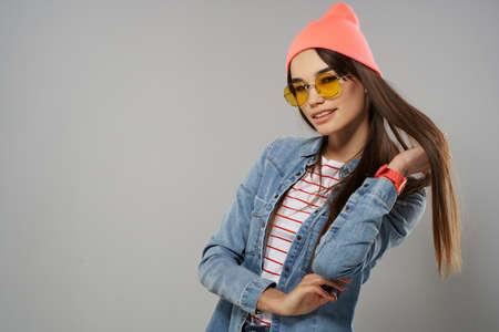 woman in denim jacket wearing glasses studio home fashion Standard-Bild