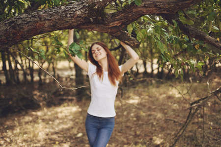 pretty woman outdoors by the tree nature Lifestyle summer