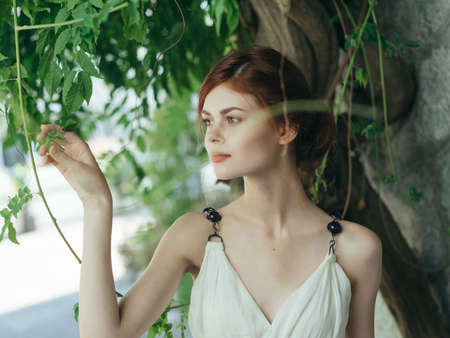 Woman in white dress near tree stone wall decoration lifestyle