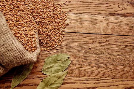 Grain bag on wooden table agriculture healthy food ingredient Standard-Bild
