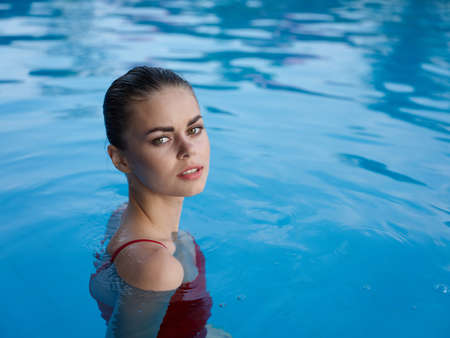 attractive woman in the pool swimwear close-up luxury