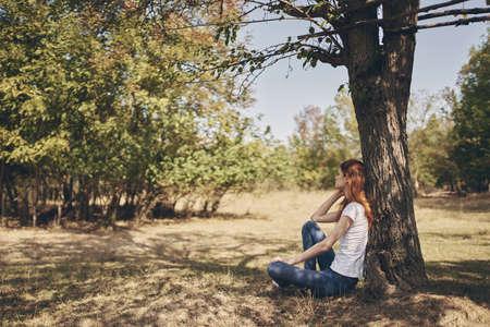 woman sitting near a tree Sun freedom journey