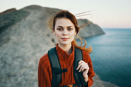 woman with backpack in mountains walk travel adventure freedom