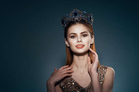 pretty woman with crown on her head princess glamor decoration model