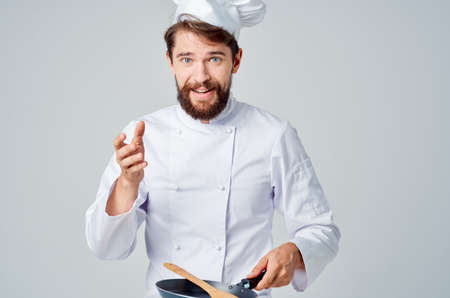 chefs with a frying pan cooking food restaurant kitchen emotions