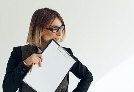 Business woman wearing glasses documents work blank sheet advertisement