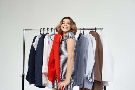beautiful woman clothes hanger shopping light background