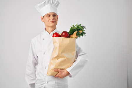 chef with a package of fresh food cooking Banque d'images