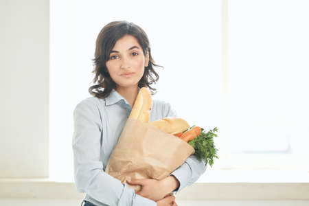 woman with a package of groceries delivery shopping service