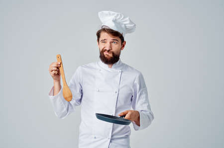 chefs with a frying pan in their hands cooking restaurant Professional