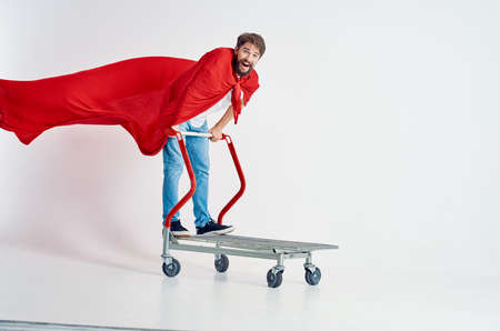 bearded man in a red cloak transport in a box isolated background