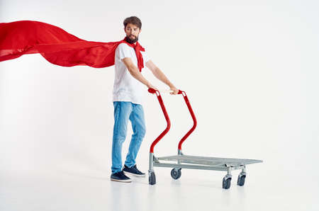 Cheerful man superhero shipping light background Banque d'images