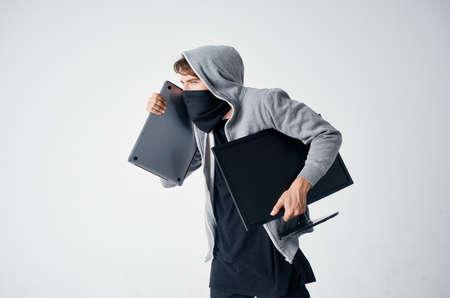 Man carry laptop and desktop background. Standard-Bild
