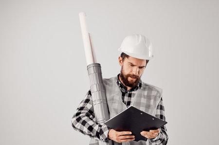 engineer in a white helmet looking at document. Standard-Bild