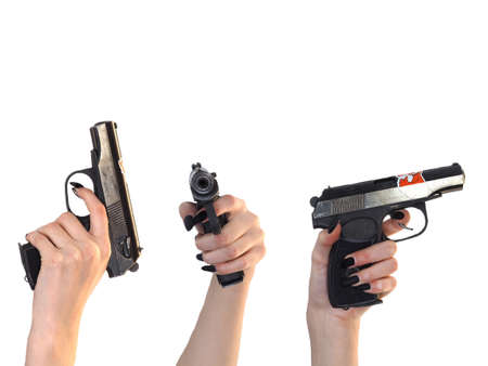 A woman's hand with a gun on white Stock Photo