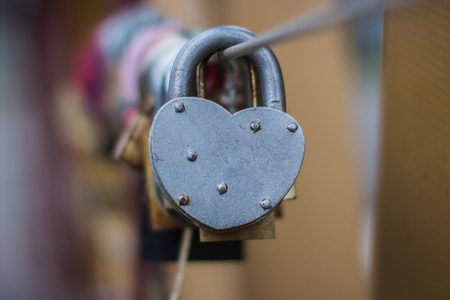door lock love: Door lock heart shape. Shallow depth of field Stock Photo
